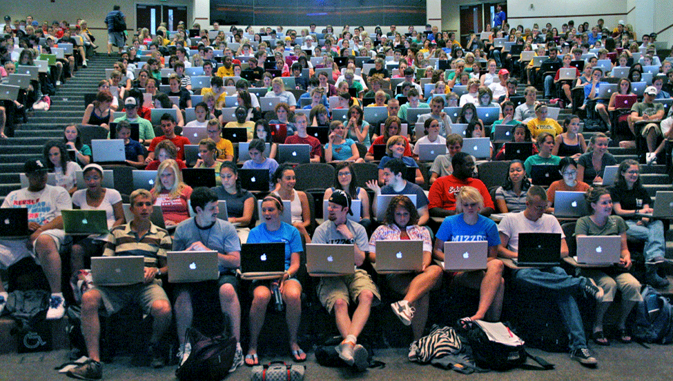 full classroom of students on computers